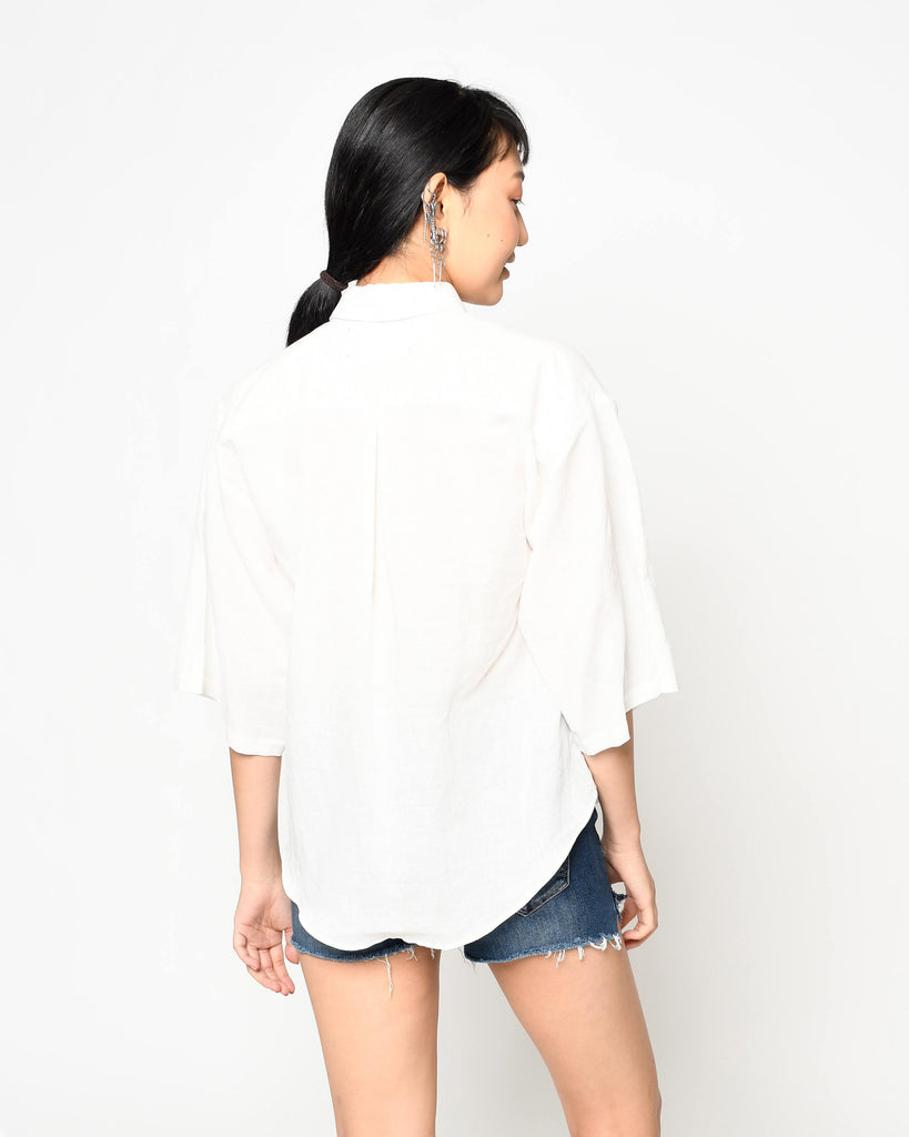 CT18738 - LINEN CAMP SHIRT - tops - shirts - This linen shirt is an essential for any wardrobe.Designed in lightweight yet luxurious linen, this boxy shirt button downs the front and features 3 quarter length sleeves. Add 1 line break Stylist Tip: Dress up with jeans or wear over a bathing suit for a chic cover up. Alternate View