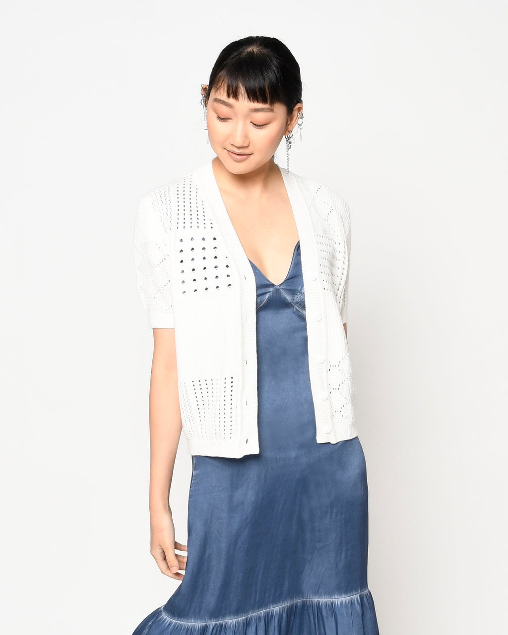 CT18862 - PATCHWORK CARDIGAN SWEATER - tops - knitwear - Our patchwork cardigan is designed in a stunning ivory color with alternating knitted patterns. Featuring 5 buttons up the front, this style can easily be worn buttoned or unbuttoned. Add 1 line break Throw on over one of our easy summer dresses.