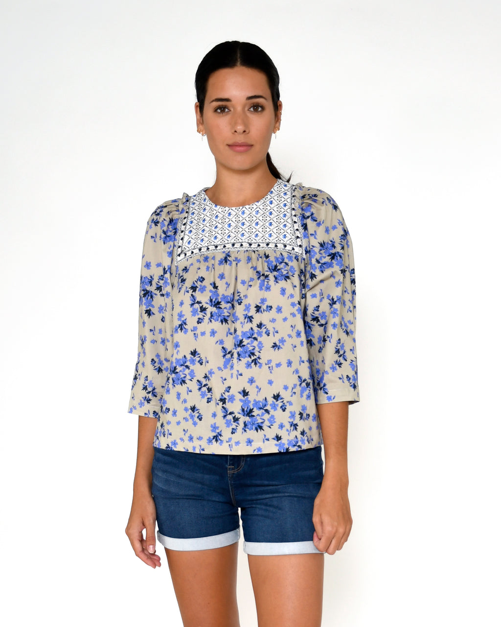 CT18921 - COUNTRY FLORAL EMBROIDERED TOP - tops - blouses - This feminine embroidered top features our bold country floral print, delicate embroidery and ruffle detail along the shoulders. Add 1 line break Stylist Tip: Pair with your favorite denim.