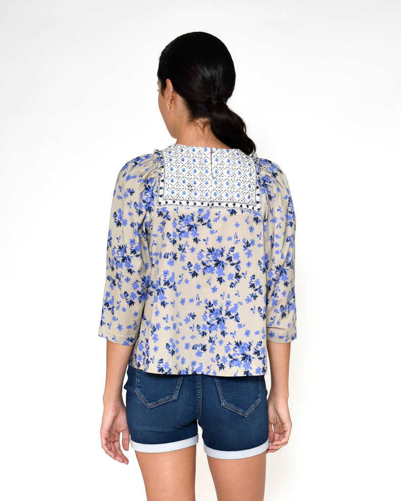 CT18921 - COUNTRY FLORAL EMBROIDERED TOP - tops - blouses - This feminine embroidered top features our bold country floral print, delicate embroidery and ruffle detail along the shoulders. Add 1 line break Stylist Tip: Pair with your favorite denim. Alternate View