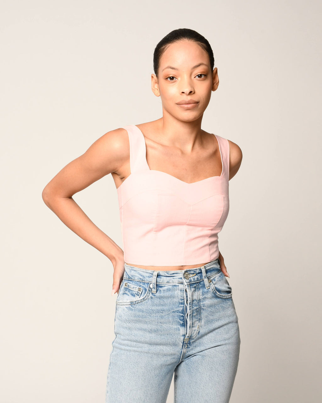 CT18966 - LINEN CROP TOP - tops - shirts - Pair our linen crop top with everything from mini skirts to denim. Crafted from breathable linen and designed in a classic crop top silhouette with thick straps. Add 1 line break Stylist Tip: Pair with one of our floral skirts.