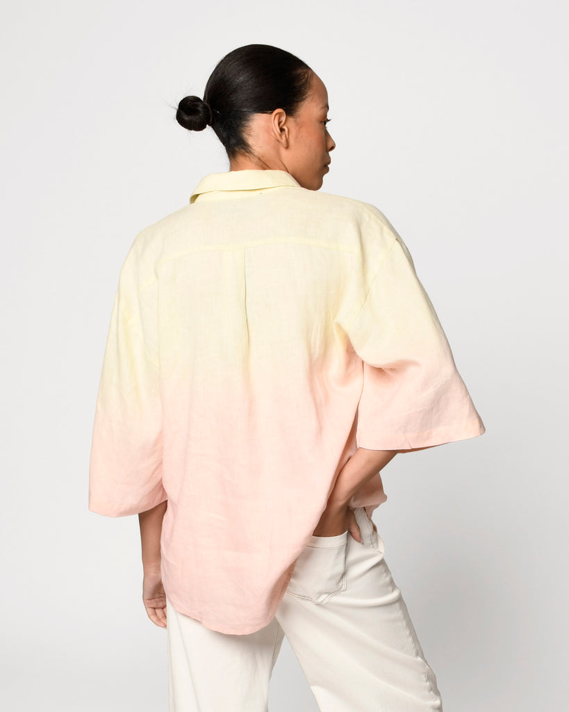 CT19056 - OVERSIZED DIP DYE LINEN SHIRT - tops - shirts - Our oversized dip dyed linen shirt is the perfect ombre of pink and yellow. Crafted from lightweight linen. Add 1 line break Stylist Tip: Wear with white denim. Alternate View