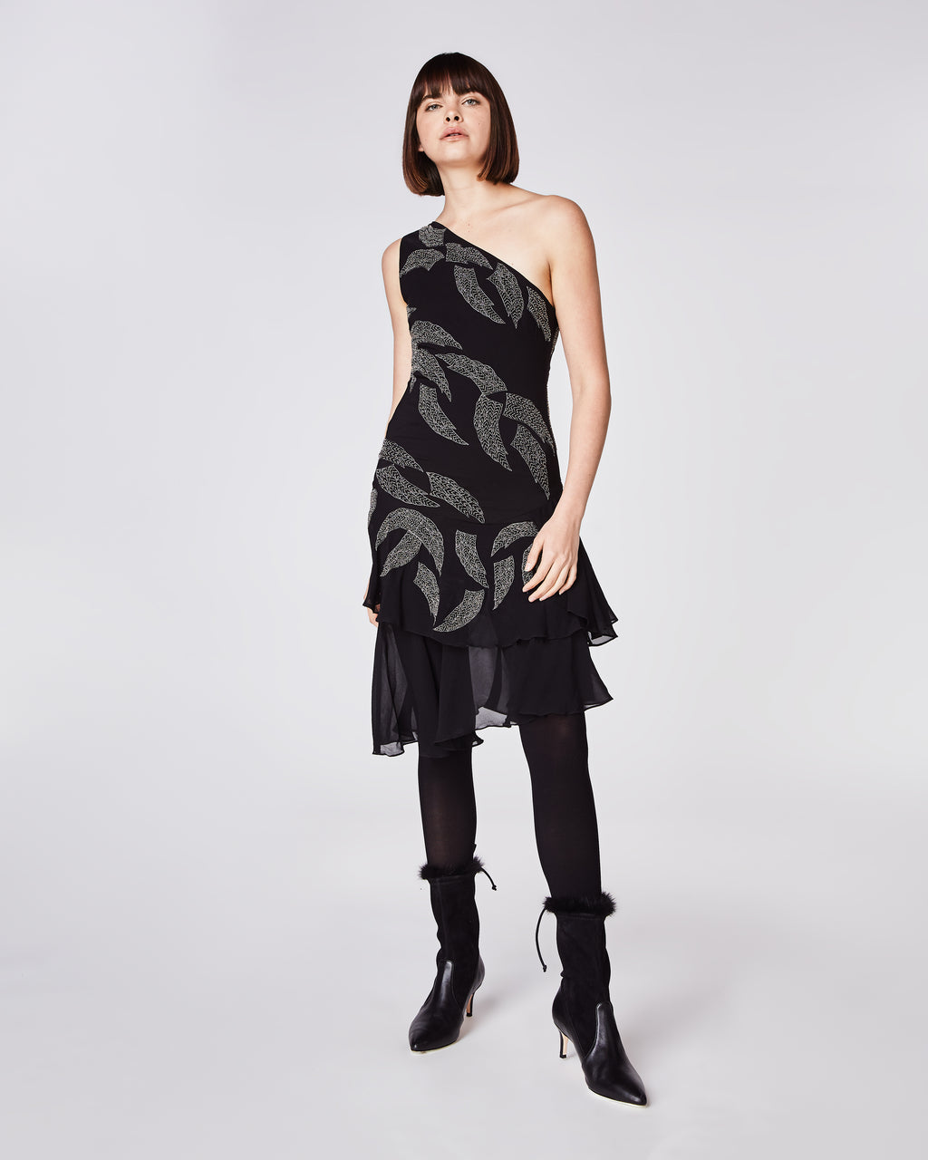 DD10074 - EMBELLISHED WING ONE SHOULDER DRESS - dresses - midi - In a one shoulder silhouette, this silk midi dressis features skillfully beaded feathers throughout and a feminine ruffled hem. Finished with a concealed zipper and fully lined.