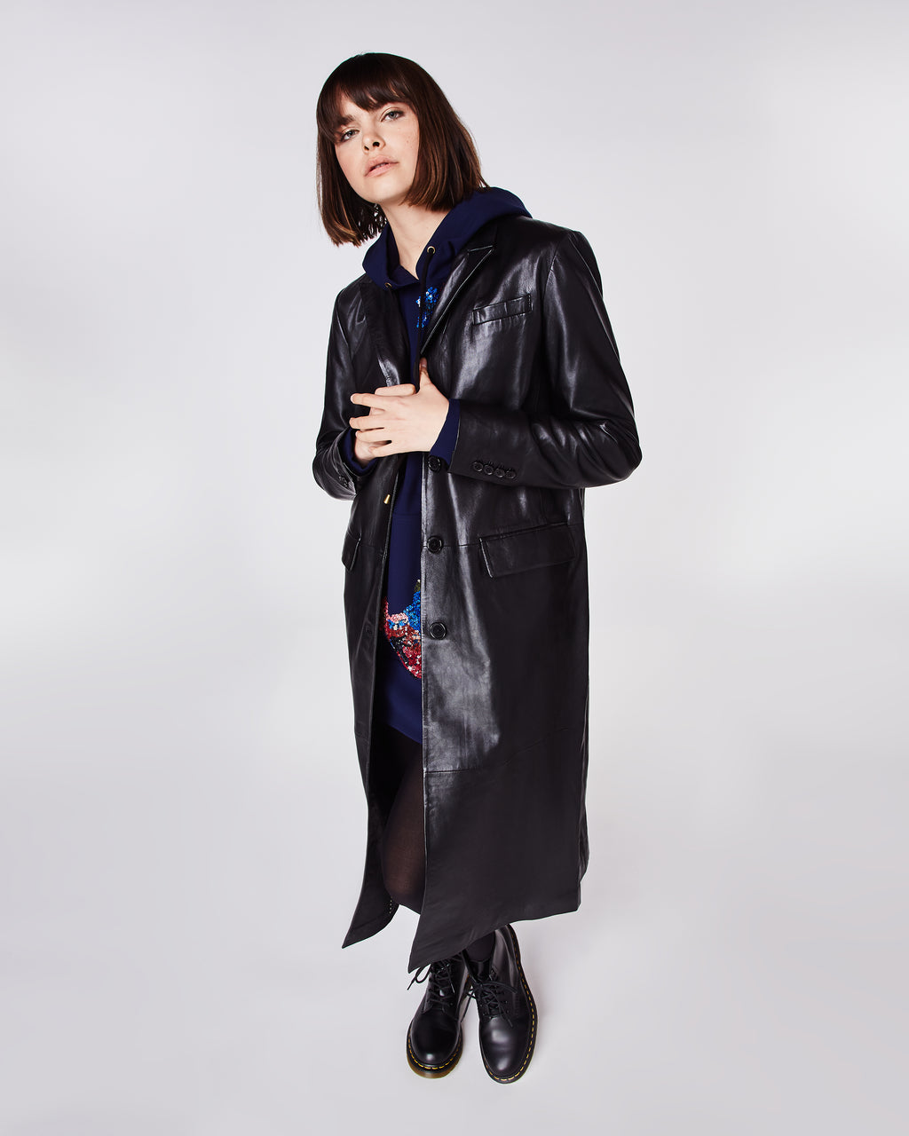DQ10005 - LEATHER REEFER COAT - outerwear - leather - Subtle, yet chic, this leather trench coat is impeccably tailored. The triple breasted closure makes this coat perfect for cooler weather. Fully lined.