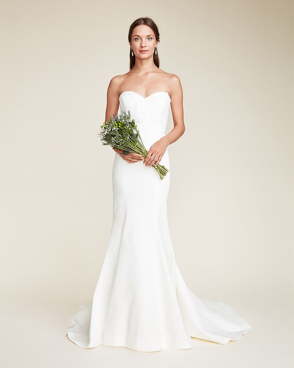 EO0009 - DAKOTA GOWN - bridal collection - bridal - This strapless bridal gown is elegant and classically simple. The sweetheart neckline and fitted bodice are figure-flattering and create a streamlined look. A fishtail train is the finishing touch to this sophisticated and modern gown.~fsbr