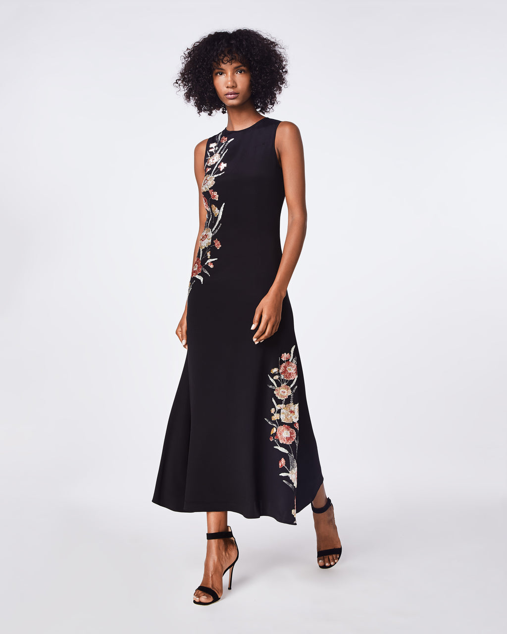 FA10010 - FALLING FLOWERS EMBROIDERY DEMI LENGTH GOWN - dresses - long - THIS BLACK GOWN FEATURES FLORAL EMBROIDERY ADDING A FEMININE TOUCH TO A CLASS BLACK DRESS STYLE. ITS HIGH NECKLINE AND FITTED THROUGH THE WAIST MAKES IT A GREAT OCCASION PIECE.