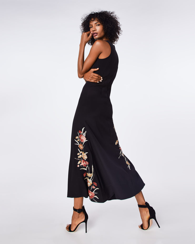 FA10010 - FALLING FLOWERS EMBROIDERY DEMI LENGTH GOWN - dresses - long - THIS BLACK GOWN FEATURES FLORAL EMBROIDERY ADDING A FEMININE TOUCH TO A CLASS BLACK DRESS STYLE. ITS HIGH NECKLINE AND FITTED THROUGH THE WAIST MAKES IT A GREAT OCCASION PIECE. Alternate View