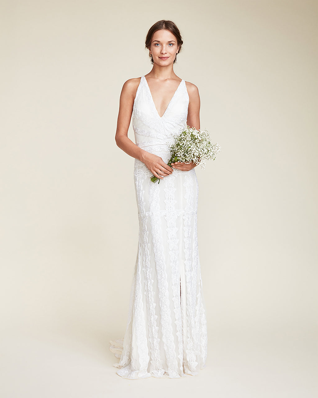 FJ10026 - BIANCA GOWN - bridal collection - bridal - Detailed embroidery throughout, this bridal gown is finished with an open back detail. Completed with a v-neck line and slit, this feminine gown is finished with a concealed zipper for closure.~fsbr