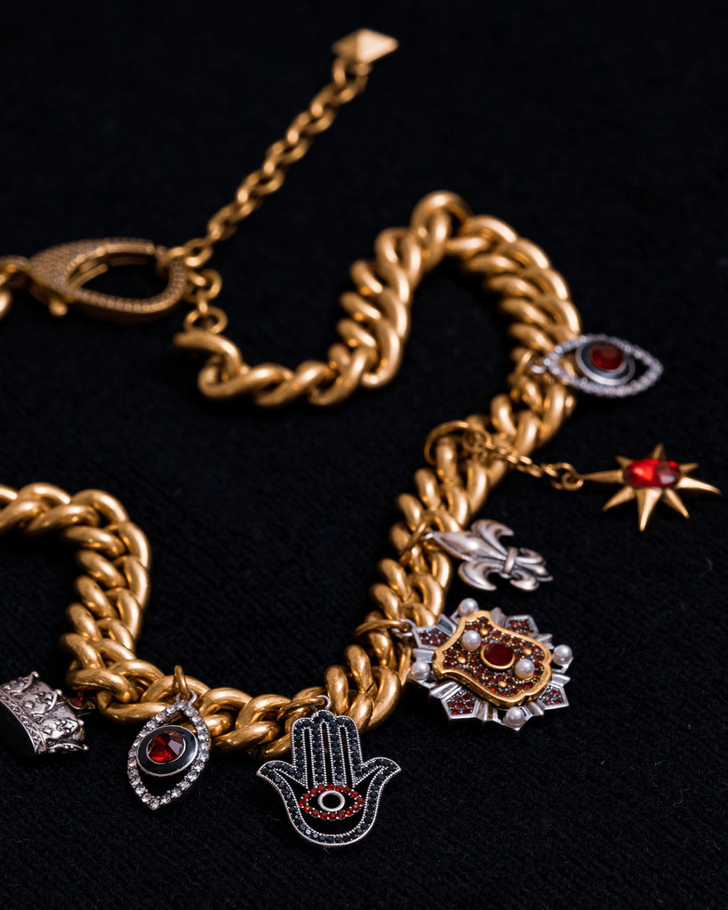 FJ15181 - GOLD CHARM NECKLACE - accessories - jewelry - This chunky gold chain is adorned with symbols inspired by our Fall 2020 Runway show - including a jeweled crown, royal crest and ruby red evil eyes. Pair this statement piece with any basic top for an upgraded look. Alternate View