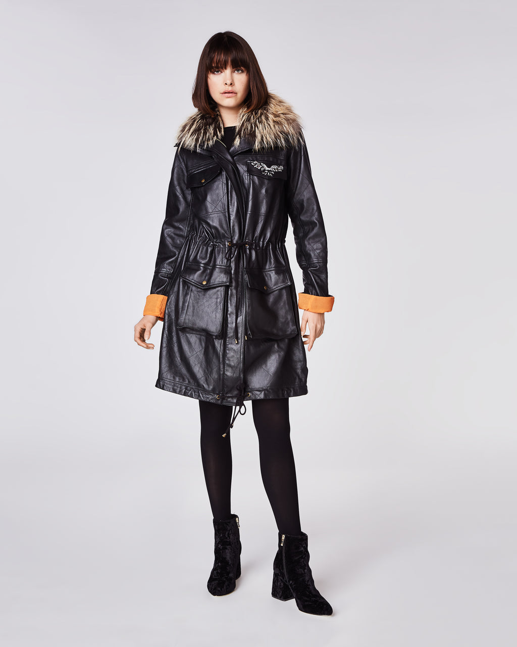 GH10010 - LEATHER PUFFER COAT - outerwear - leather - With quilted details, this leather puffer coat features a fox-trim along the collar and a draw string at the waist. Finished with an exposed zipper and embellished eagle. Fully lined.