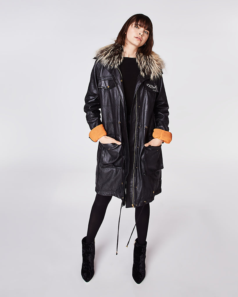 GH10010 - LEATHER PUFFER COAT - outerwear - leather - With quilted details, this leather puffer coat features a fox-trim along the collar and a draw string at the waist. Finished with an exposed zipper and embellished eagle. Fully lined. Alternate View