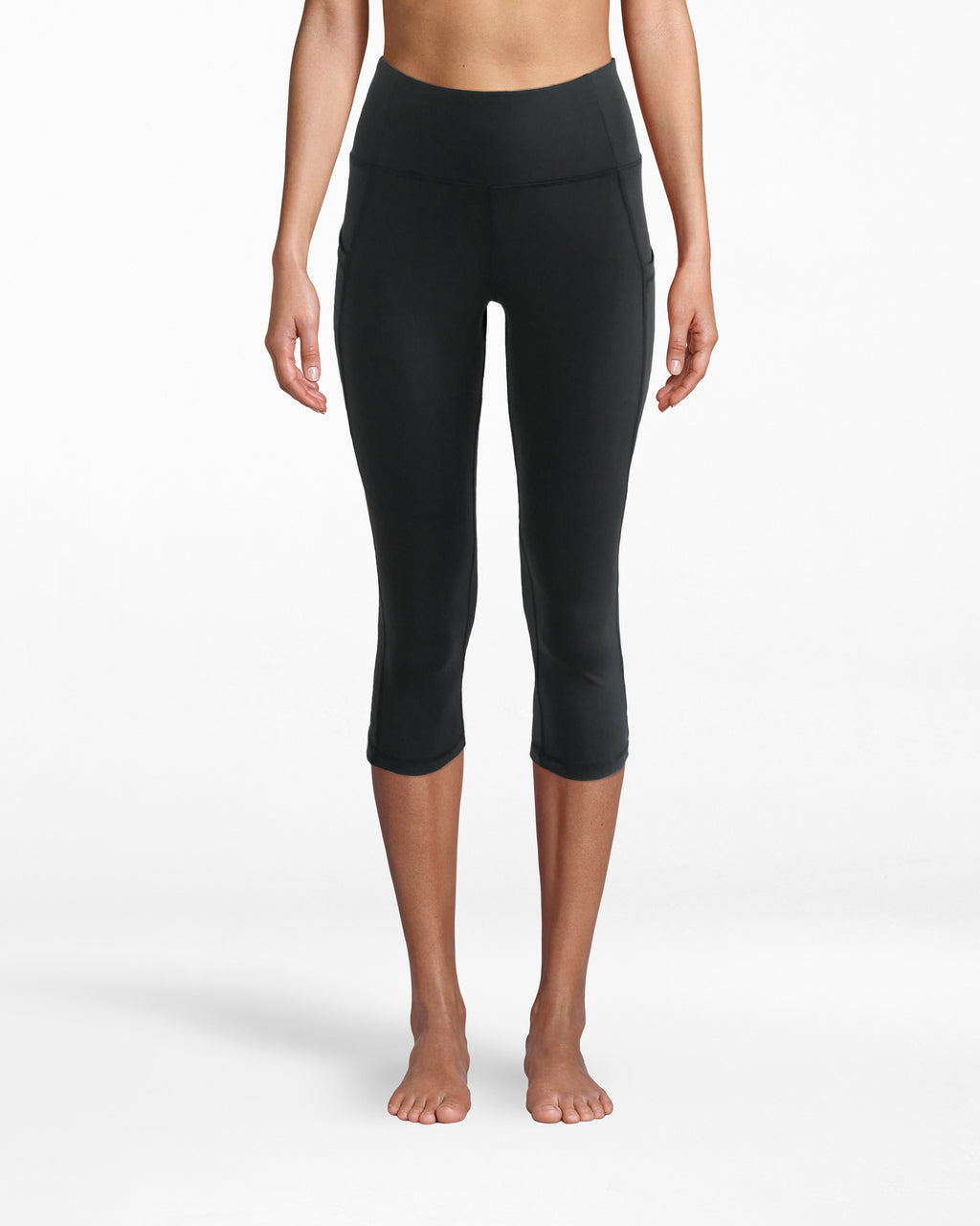 N8ZN001 - Solid Capri Legging - activewear - activewear bottoms - Ideal for yoga or any lazy day. Our Slim Capri 19 inch compression legging fits smoothly onto your form. The high waistband is comfortable yet structured. The fit makes motion feel free and effortless.