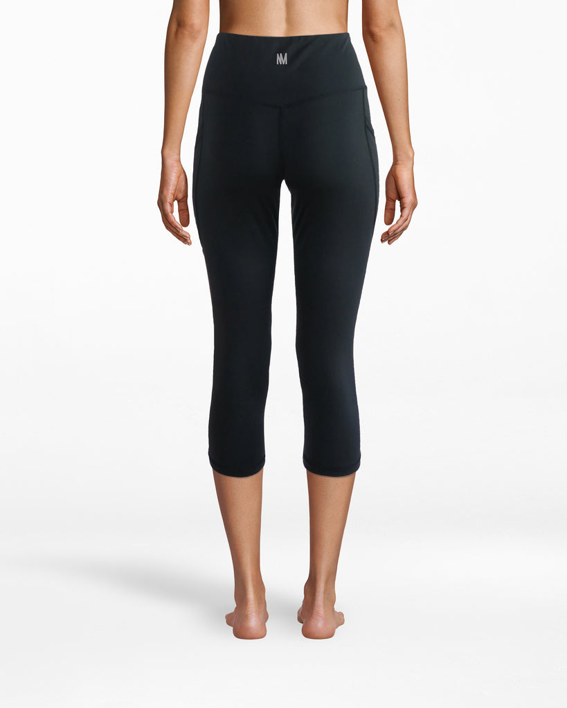 N8ZN001 - Solid Capri Legging - activewear - activewear bottoms - Ideal for yoga or any lazy day. Our Slim Capri 19 inch compression legging fits smoothly onto your form. The high waistband is comfortable yet structured. The fit makes motion feel free and effortless. Alternate View