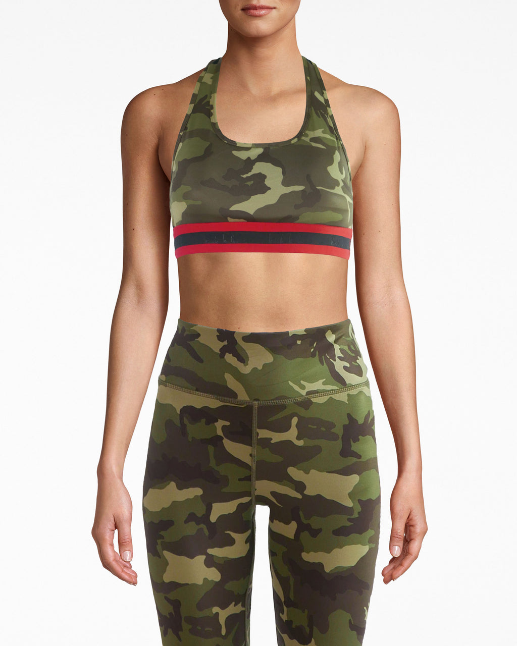 N8ZQ004 - Mesh Back Sports Bra - activewear - activewear tops - Work out duty. The racerback on this padded sports bra features mesh, with camouflage lining. The Nicole Miller logo circles around the black and red under band. The stretchy fabric helps you feel comfortable and protected.
