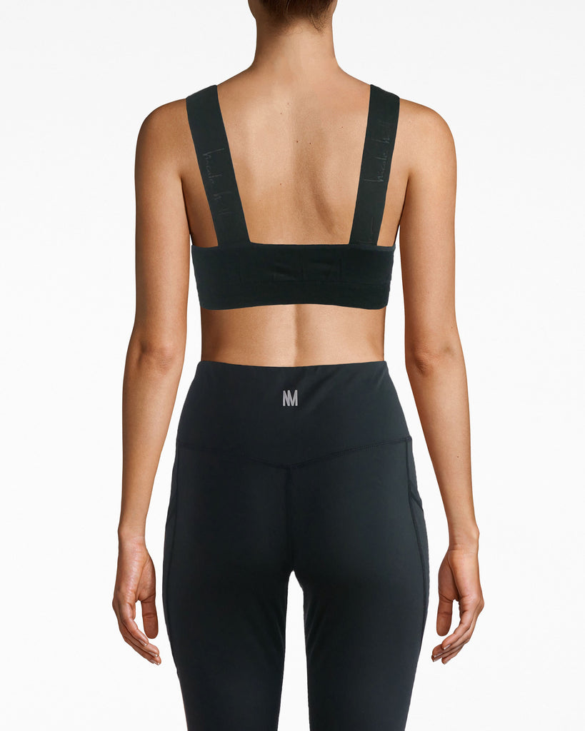 N8ZQ005 - Wide Strap Seamless Sports Bra - activewear - activewear tops - TFW your sport bra looks great outside of the gym. This wide strap seamless padded bra is stretchy and supportive throughout and ribs at the under band. The Nicole Miller logo is subtly featured on the straps. Full coverage is ensured for your best performance. Alternate View