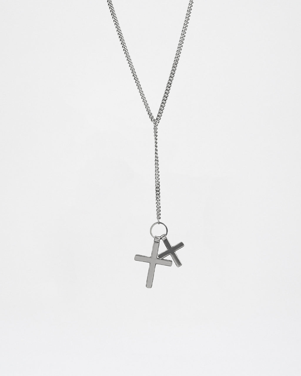 NM01511 - Soft Cross Y-Necklace - accessories - jewelry - this long silver necklace features two crosses. It's a great piece to layer with most outfits.