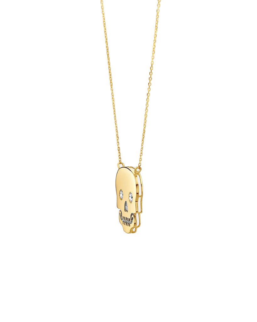 NM10007 - 14k Sparkle Eye Skull Necklace - accessories - fine jewelry - Hanging from an 18 inch chain is a 14-karat solid yellow gold skull, which is embellished with cubic zirconia for an extra touch. Perfect as a stand-alone piece or when layered. Alternate View