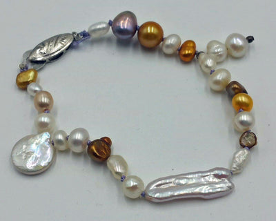 Vintage, silver, multi-colored baroque pearl, lavender silk, bracelet. Very pretty.