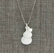 Nearly white celadon jadeite pendant shaped like a gourd. Sterling silver chain.