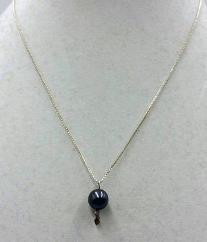 Sterling silver, black Tahitian pearl pendant necklace.