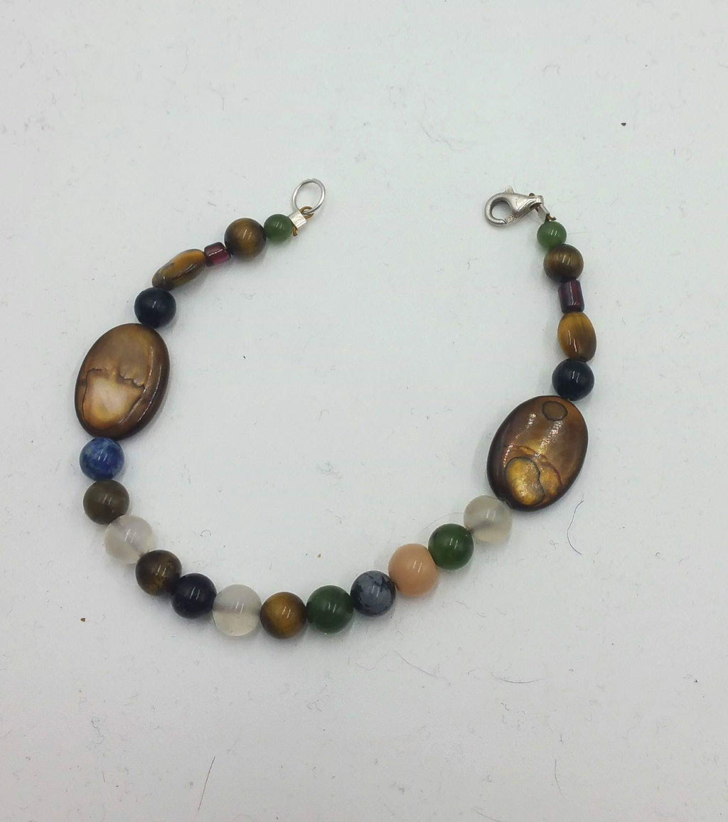 Multi-stone, shell, tiger's eye, garnet, nephrite, sterling bracelet.