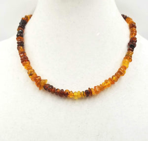 "Strand of variegated honey, cognac, brandy, & butterscotch Baltic amber with Sterling silver. 19"" Princess length"