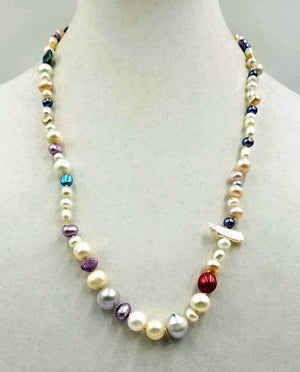 Short rope of multi-color Baroque pearls, hand-knotted on beige silk.