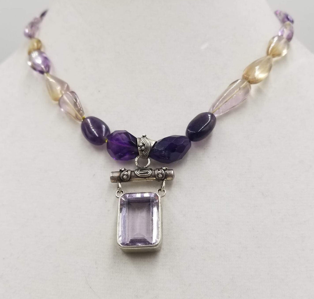 Bold. Amethyst & sterling silver pendant on a necklace of amethyst, citrine, & yellow silk.