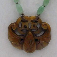 Rope length, ombre, jadeite necklace with vintage nephrite bat pendant on chocolate silk.