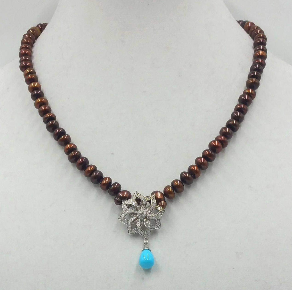 "Get your sunglasses. This amazing necklace is blinding.  14KWG, bronze pearl necklace with 14KWG .72ct diamond & turquoise pendant on hand-knotted purple silk. 19.50"" Length."