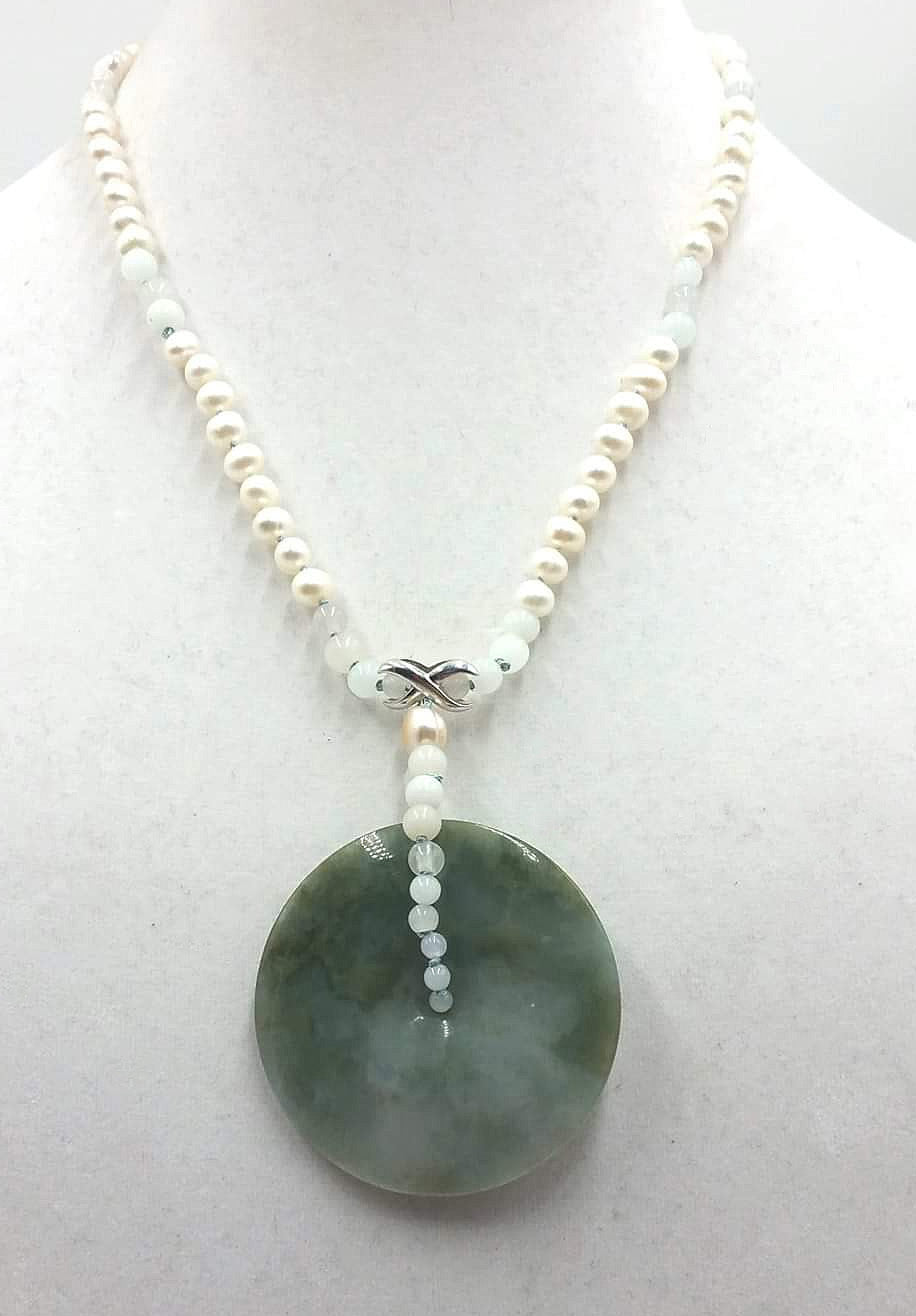 Large Jadeite pendant on pearl, 14K (white & yellow) gold accent necklace on blue silk.