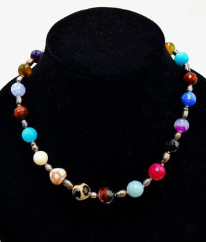 Multi-color faceted agate, black pearl cosmic necklace on beige silk, sterling toggle clasp.