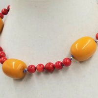 "Unusual & Bold. 14KYG, coral and bold faturan choker, white silk. 17.5"" length."