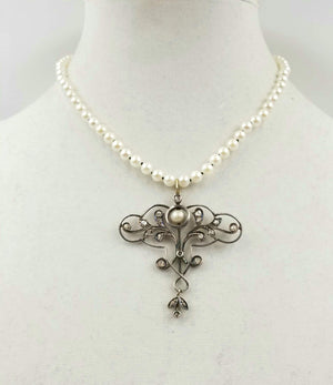 Art Nouveau rose-cut diamond, 14K gold, half pearl pendant on pearl strand.