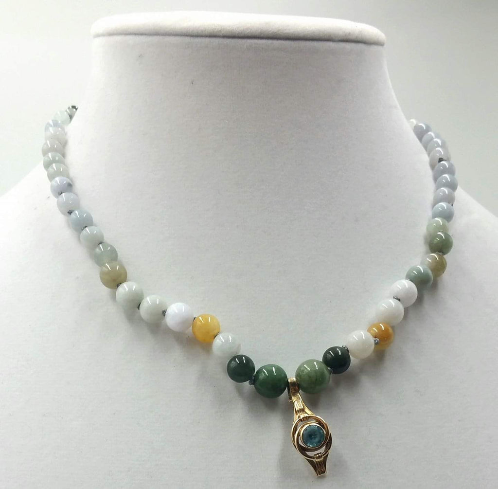 Ombre graduated jadeite necklace with vintage 10KYG, blue topaz pendant & 14KG clasp on grey silk.