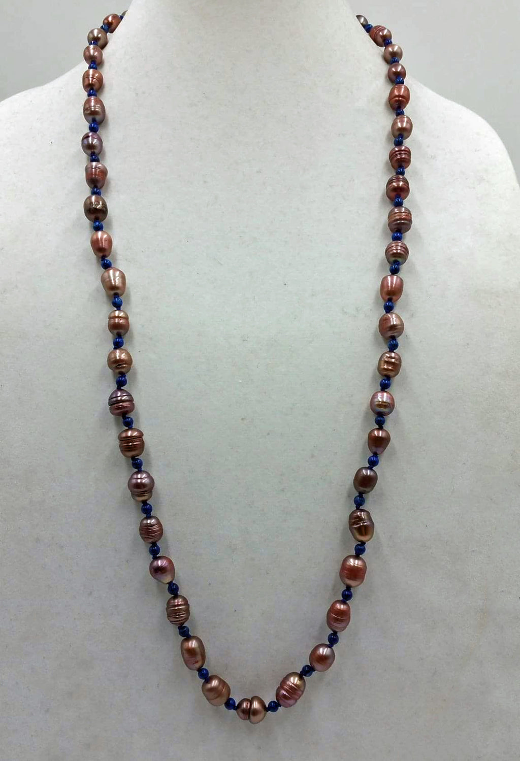 Past Work.  Rope of mauve pearls & lapis lazuli on navy silk. Sold