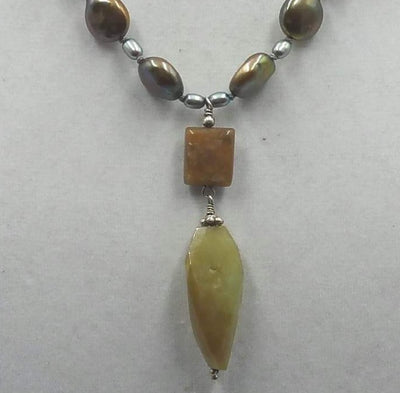 Onyx pendant on 3-tone pearl & sterling silver necklace on grey silk. 19