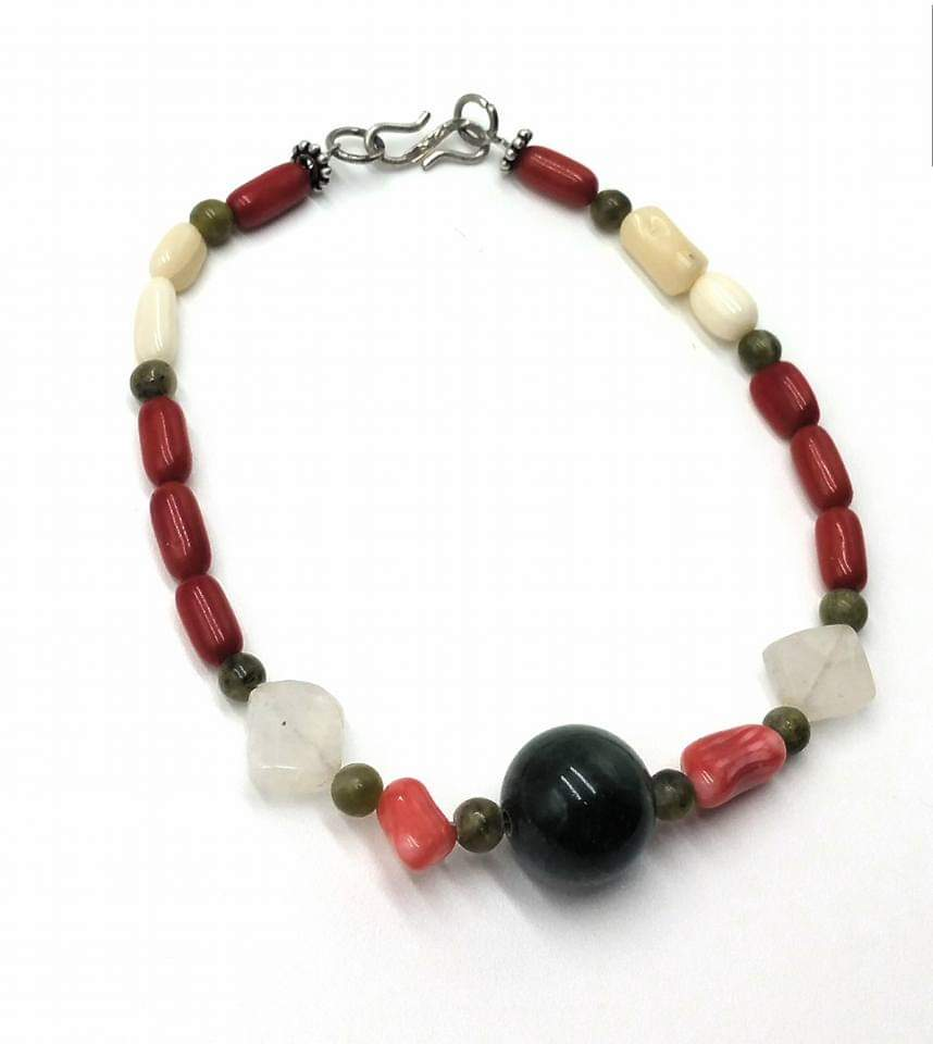 Past Work. Nephrite, coral, moonstone, sterling silver bracelet. Sold