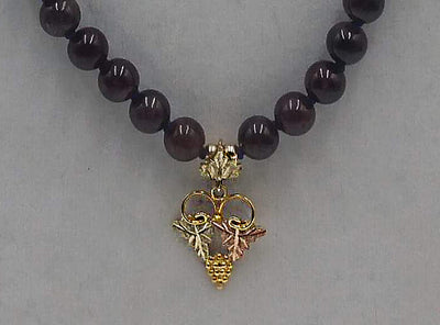Gold, Garnets, Silk. Gorgeous.