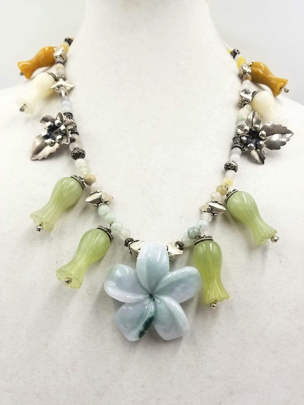 Up for auction at Ogallerie.com Sept 17-18. Chinese squash blossom necklace, sterling silver, jadeite,&  aventurine.