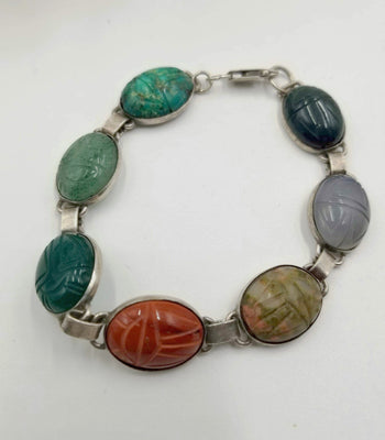 Scarab bracelet made of varied stones carved as scarabs, sterling silver. 7