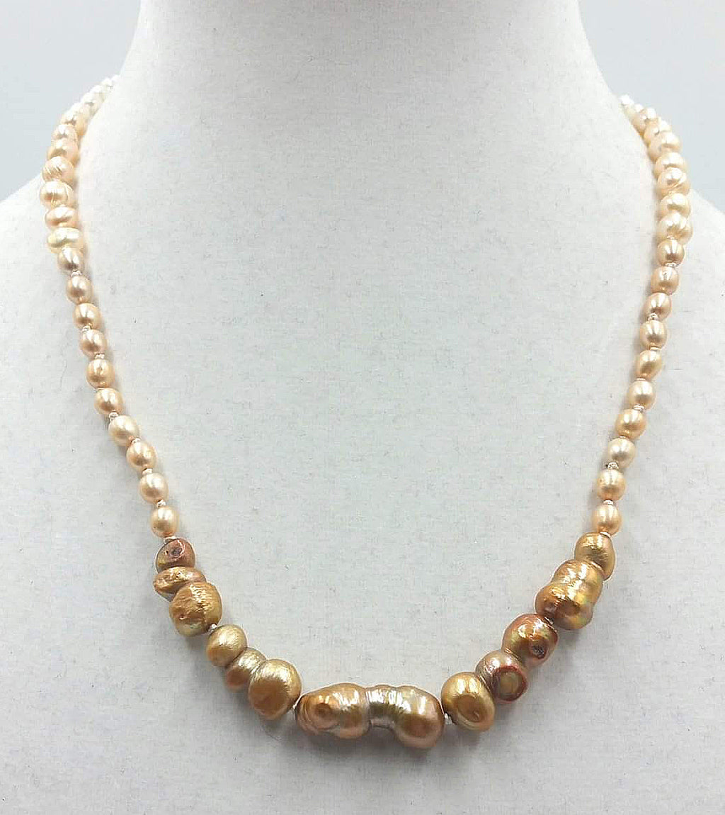 "Ombre pearl necklace on white silk with 14K white gold clasp. 20.5"" length.  Matinee."