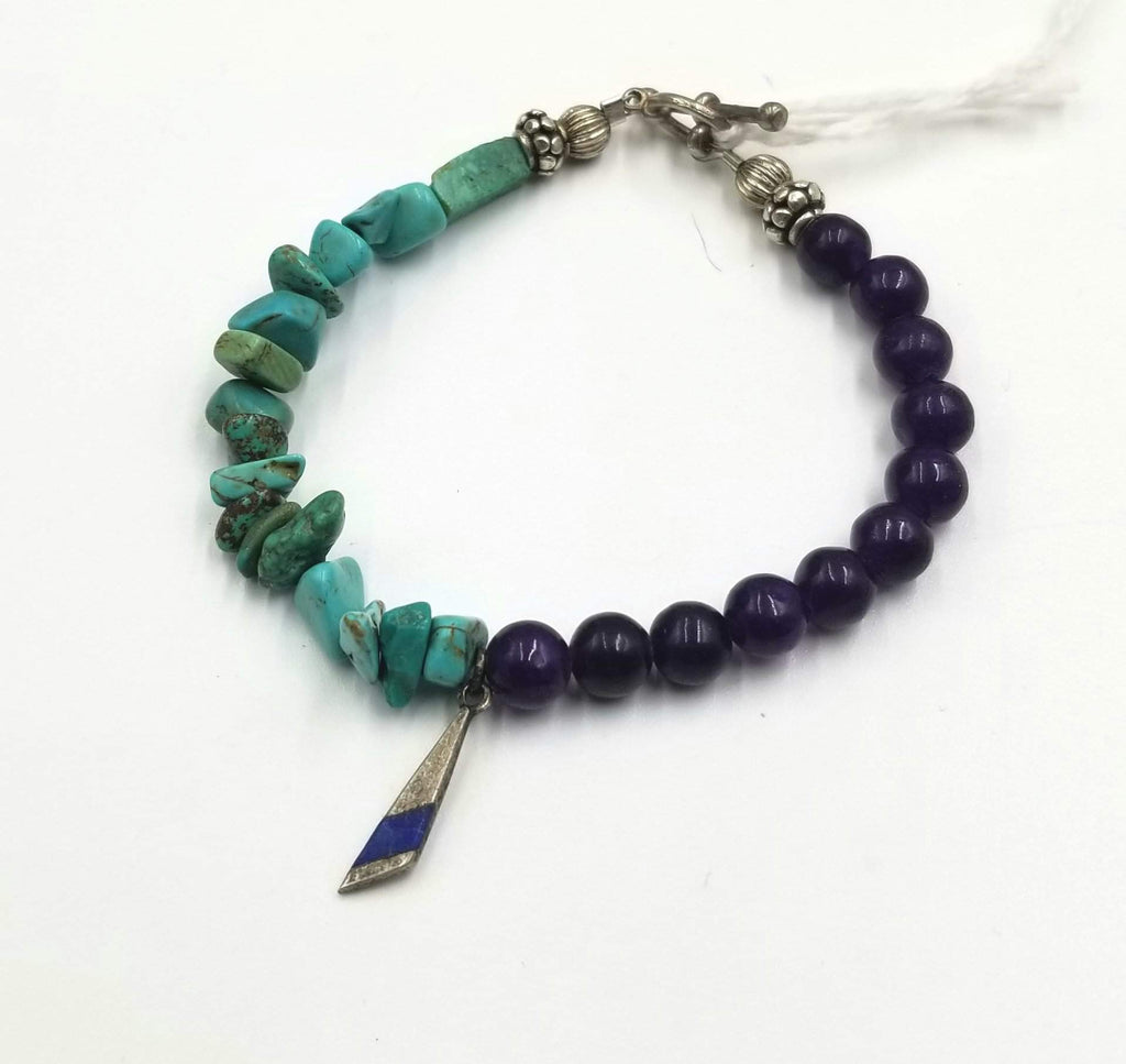 "Very pretty. Turquoise, howlite, fluorite, sterling, lapis lazuli, toggle bracelet. 7"" Length."