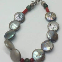 Freshwater pearl, coral, nephrite, sterling silver bracelet.