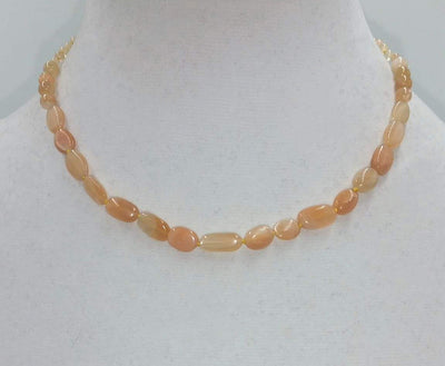 Butterscotch candy? No, it is a sunstone graduated necklace on yellow silk with 10K gold clasp. 16
