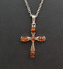 Bold Baltic amber & sterling silver cross pendant on long chain.