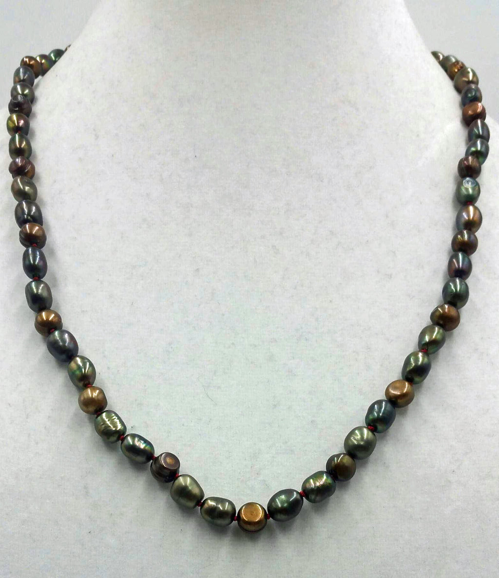 Bronze pearl necklace, matinee length on scarlet silk.