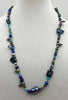 "Black, blue, silver pearls, sodalite, turquoise with sterling silver accents.  26"" Opera length."
