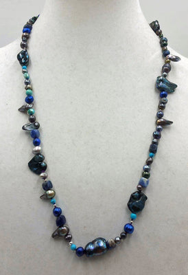 Black, blue, silver pearls, sodalite, turquoise with sterling silver accents.  26