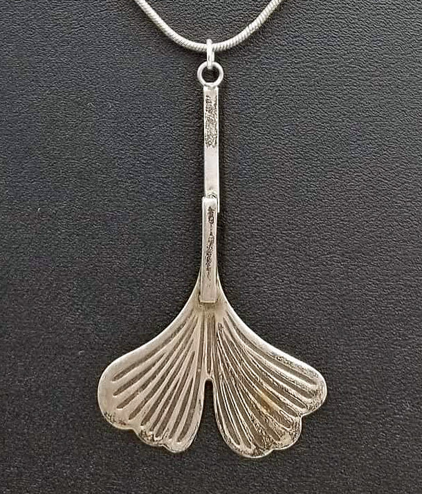 Sterling silver ginkgo leaf pendant necklace.
